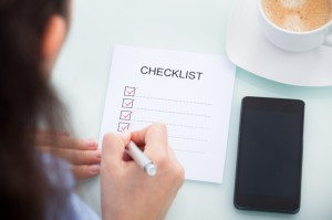 Businesswoman Marking On Checklist